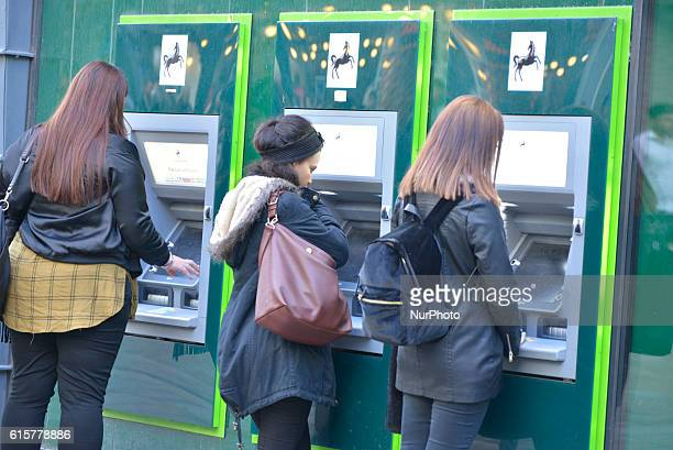 People withdraw money from Lloyds a provider of mortgages for people purchasing property cash manchines on October 19 2016 in Manchester England The...