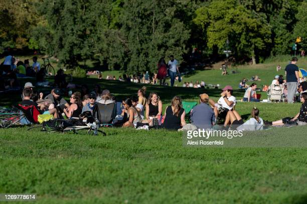 People without masks avoid social distancing while sitting in Prospect Park, Brooklyn as the city continues Phase 4 of re-opening following...