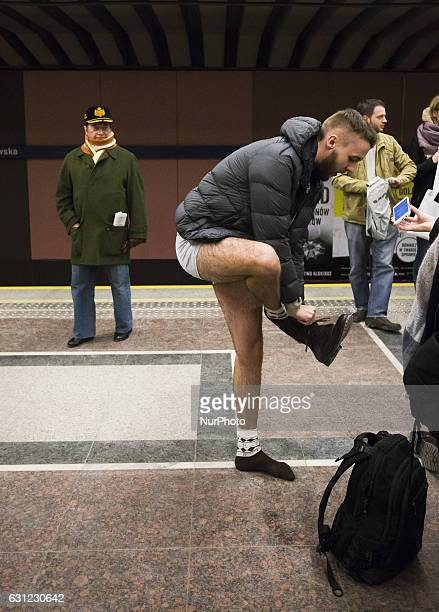 People without pants ride an underground train on January 8 2017 in Warsaw Poland The annual event called 'No Pants Day' is a whimsical Facebook call...