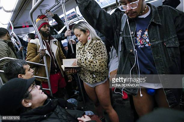 People without pants travel in the subway during the 'No Pants Subway Ride' in New York on January 8, 2017. The event, which first took place in New...
