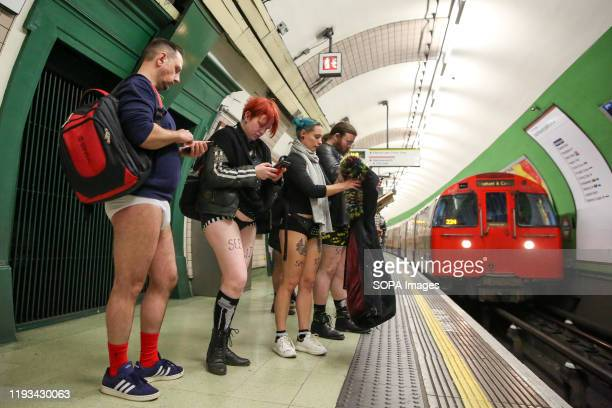 People without trousers ride on the Circle Line as they take part during the 11th 'No Trousers Tube Ride' event on the London underground. The No...