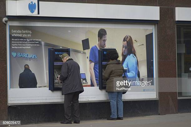 People withrdawing cash from a cash machine at a branch of Barclays Bank in the City of London London England United Kingdom on Tuesday 23rd February...