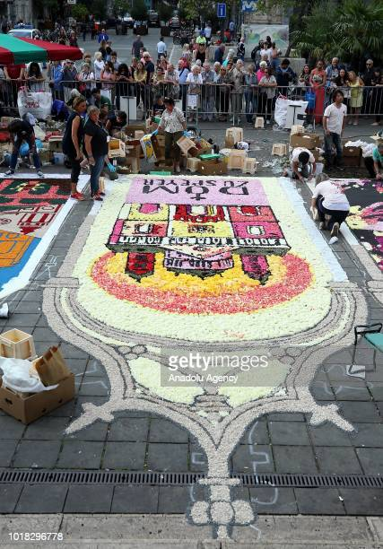 People work at Brussels' Bourse Place on the floral Unesco exhibition that marks the 20th anniversary of the GrandPlace was recognised as a Unesco...