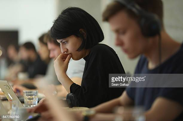 People work at computers in the community space of Factory Berlin on July 14 2016 in Berlin Germany Factory Berlin is a commercial space that has...