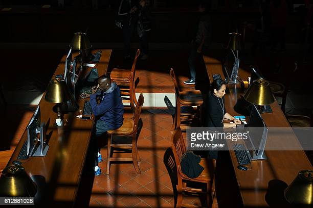 People work at desks in the Bill Blass Public Catalog Room adjacent to the Rose Main Reading Room at the New York Public Library October 5 2016 in...