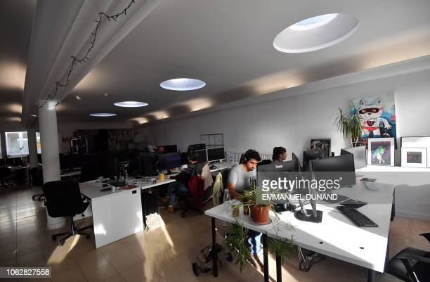 People work at LaVallee a 6000 squaremetre coworking space at the heart of the Brussels district of Molenbeek on November 14 2018 The French...