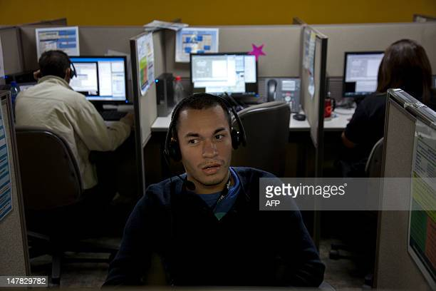 People work at SITEL, an outsourcing call center provider, in Managua on July 03, 2012. AFP PHOTO / Nicolas GARCIA