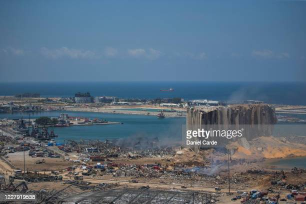 People work at the site were a massive explosion occurred that shook the city the day before on Aug. 5, 2020 in Beirut, Lebanon. As of Wednesday...