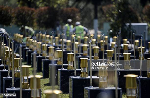 People work in a cemetery in the Turkish town of Soma in the Manisa district on May 11, 2015 to clean and put in order the graves of miners killed...