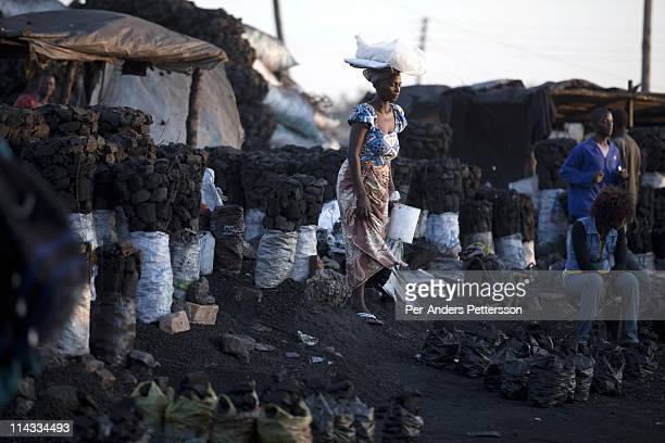 People work in a charcoal market on June 17 2010 in central Lusaka Zambia Many people in Zambia uses charcoal for cooking Cook stoves are supplied by...