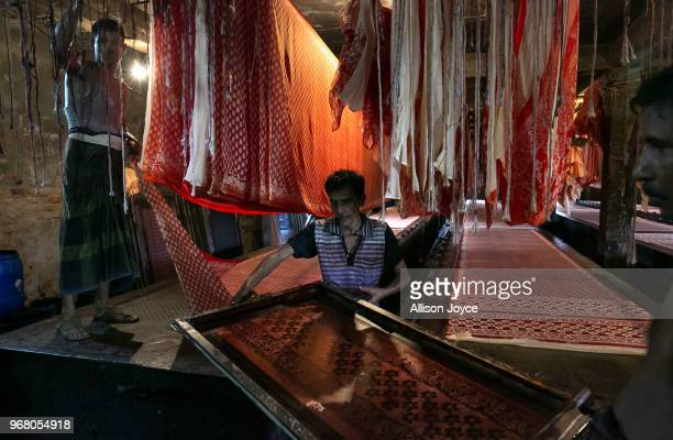 People work in a dying factory in Shyampur whose waste is dumped into the Buriganga river on June 4 2018 in Dhaka Bangladesh Bangladesh has been...