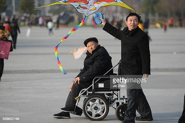 People work in a Public square in Hefei Anhui province east China on 7th March 2015 China has lowered its annual GDP growth target to around 7 per...