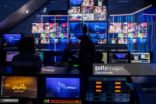 People work in the broadcast control booth during a live broadcast of a news show at Belqees TV of Yemen on October 30 2018 in Istanbul Turkey...