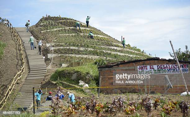 People work in the Commune 4 Moravia shantytown in Medellin Antioquia department Colombia on April 9 2014 Moravia which in 30 years accumulated tons...