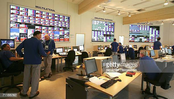 People work in the Master Control Room of the TV provider Host Broadcast Services in the International Broadcast Center of the FIFA World Cup 2006 on...