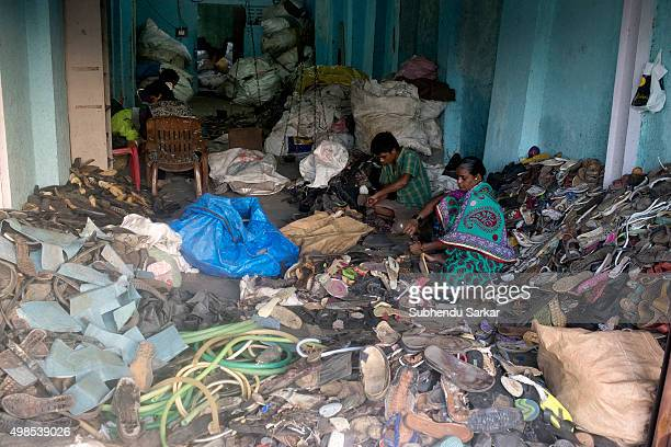 People work inside a factory in Dharavi Dharavi houses one of the largest slums in the world Dharavi slum was founded in 1882 during the British...