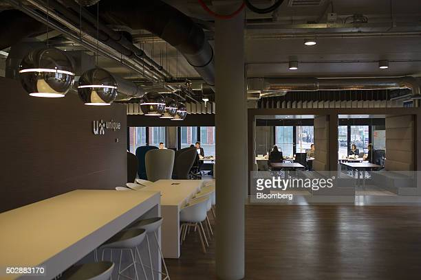 People work inside the Unique job center flagship store operated by USG People NV in Amsterdam Netherlands on Tuesday Dec 29 2015 Recruit Holdings Co...