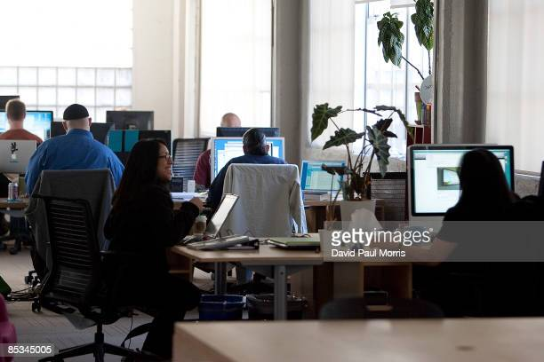 People work inside Twitter headquarters March 10, 2009 in San Francisco, California. Twitter, the new social networking service that allows users to...