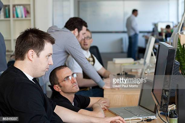 People work inside Twitter headquarters March 10 2009 in San Francisco California Twitter the new social networking service that allows users to send...