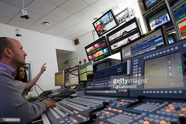 People work on a mixing console at the I Tele news channel office on January 31 2011 in Paris AFP PHOTO LOIC VENANCE