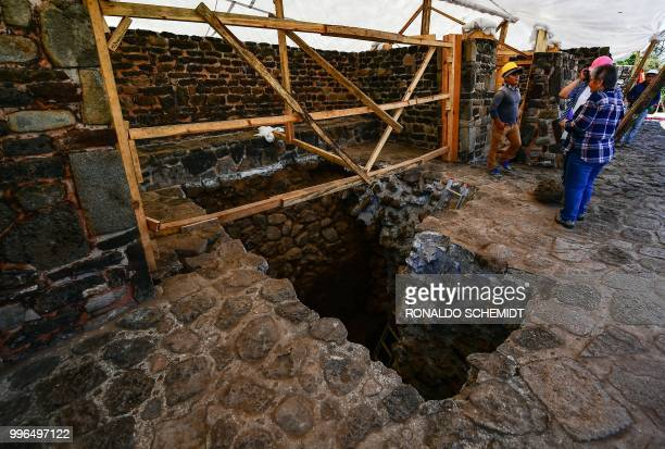 People work on a substructure inside the Teopanzolco pyramid in Cuernavaca Morelos State Mexico on July 11 2018 After an earthquake took place on...