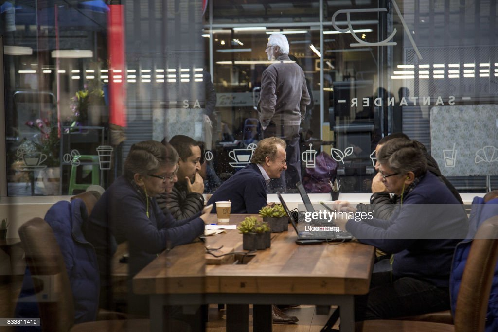 People work on laptop computers at Banco Santander Chile's Work/Cafe in Santiago, Chile, on Wednesday, Aug. 16, 2017. Banco Santander Chile is the largest bank in the region in terms of total assets and equity. Photographer: Cristobal Olivares/Bloomberg via Getty Images