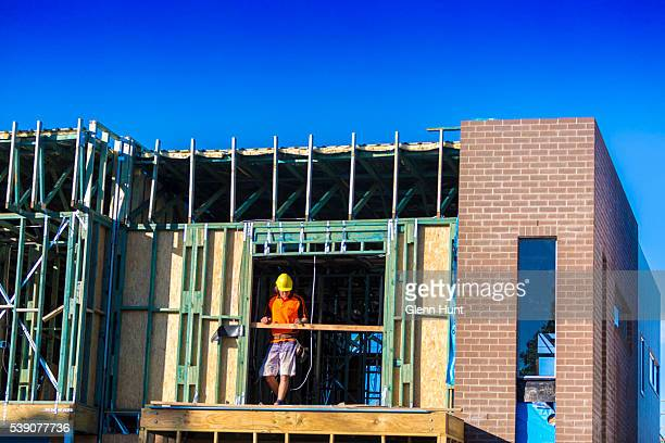 People work on new housing at North Lakes on June 10 2016 in Brisbane Australia Economic forecasts suggest Brisbane is on track to overtake Melbourne...