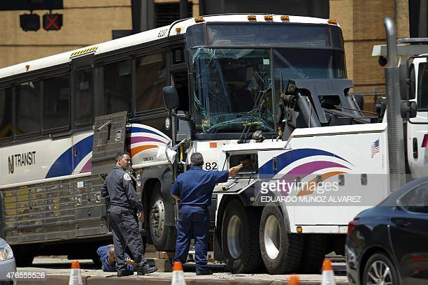 People work on one of the two buses involved in Lincoln Tunnel bus accident in the Manhattan bound tube in on June 10 2015 in New York Thirtyone...