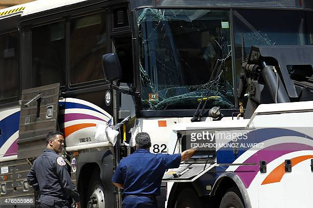 People work on one of the two buses involved in the Lincoln Tunnel bus accident in the Manhattan bound tube on June 10 2015 in New York Thirtyone...