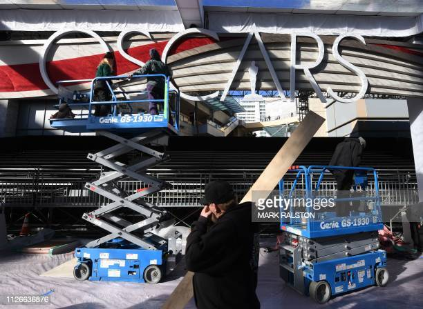 People work on the red carpet area as preparations for the 91st Academy Awards take place in Hollywood on February 21 2019 The annual Academy Awards...