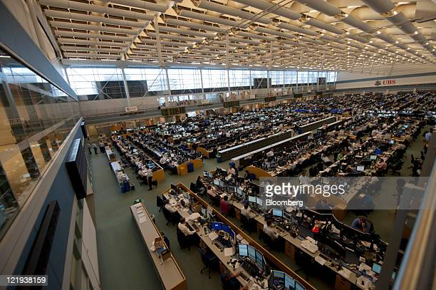 People work on the trading floor of UBS AG's office in Stamford Connecticut US on Tuesday Aug 23 2011 UBS AG Switzerland's biggest lender promised to...