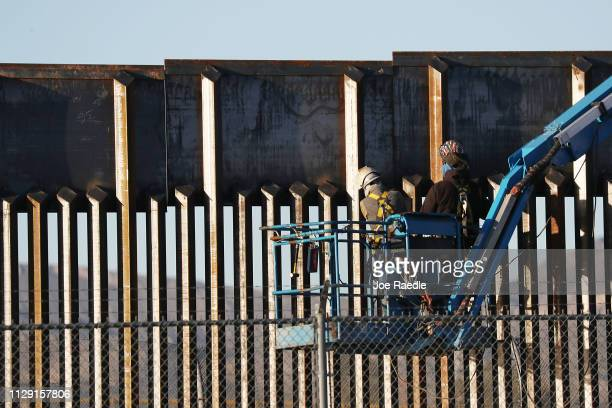 People work on the US/ Mexican border wall on February 12 2019 in El Paso Texas US President Donald Trump visited the border city yesterday as he...