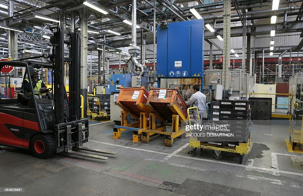 People Work To Make Car Parts Inside The French Carmaker Peugeot