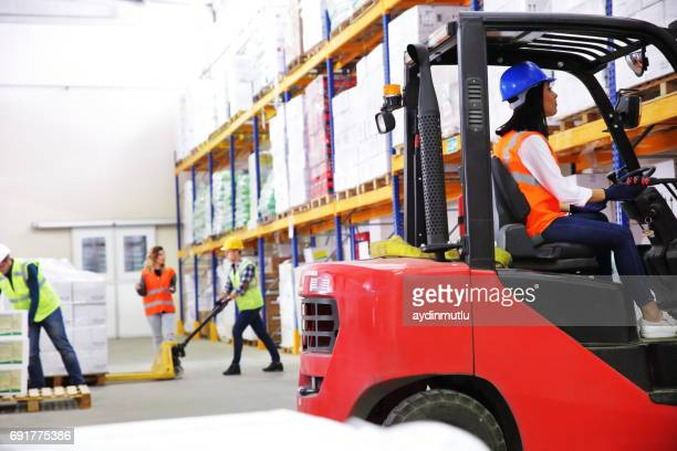 People working at a distribution warehouse