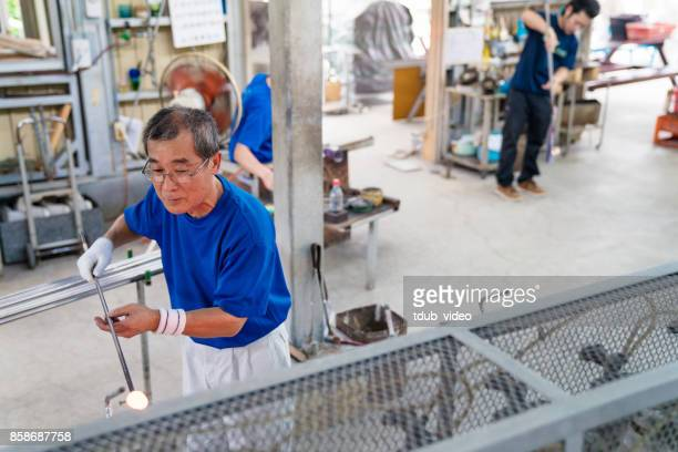People working at a glass factory