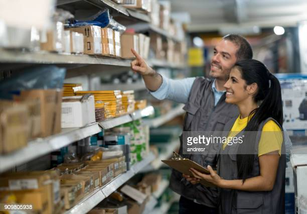 people working at a hardware store - office supply stock photos and pictures
