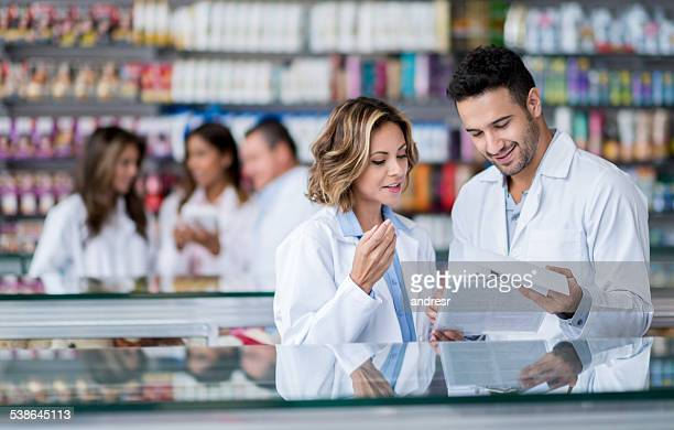 People working at a pharmacy