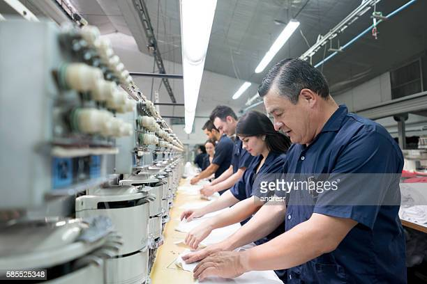 people working at an embroidery factory - textile industry stock pictures, royalty-free photos & images