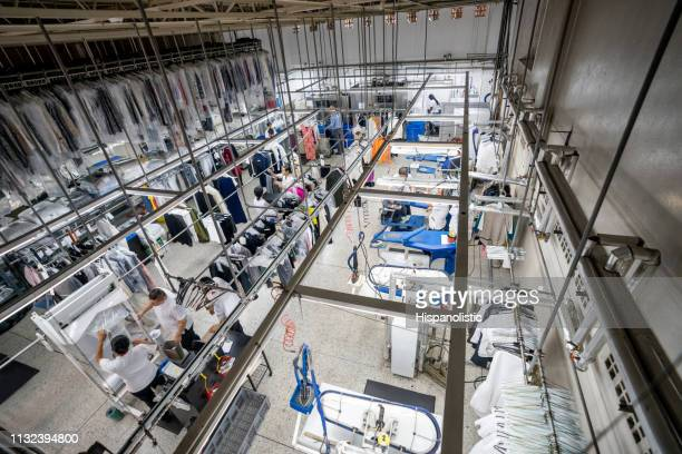 people working at an industrial laundry service - laundry stock pictures, royalty-free photos & images