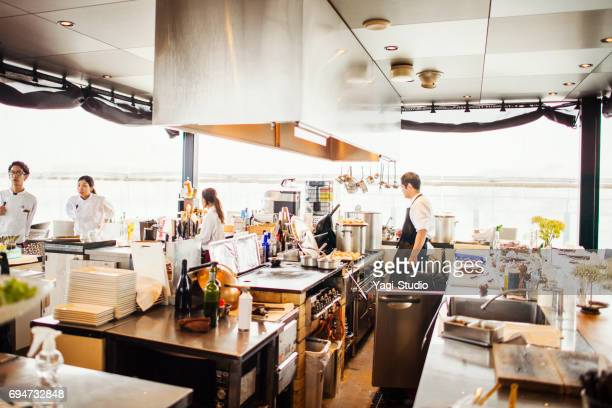 people working at an open air restaurant - commercial kitchen stock pictures, royalty-free photos & images