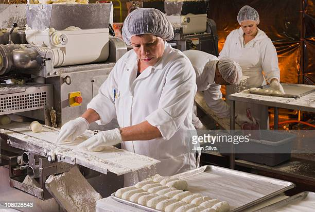 People working at food processing plant