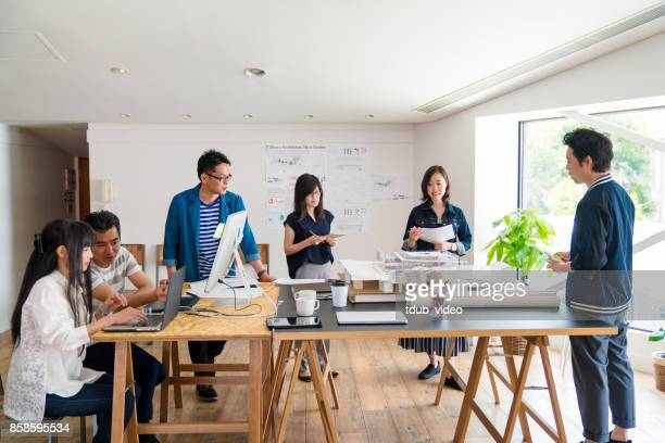 people working at office - tdub_video stock pictures, royalty-free photos & images