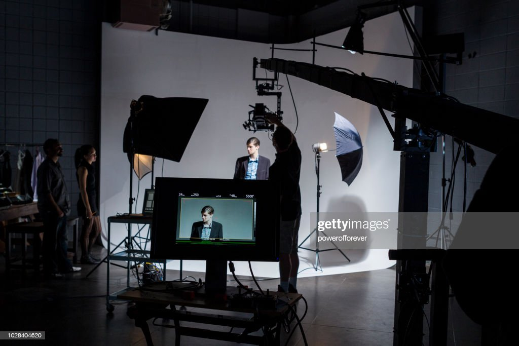People Working Behind the Scenes on a Film Set : Stock Photo