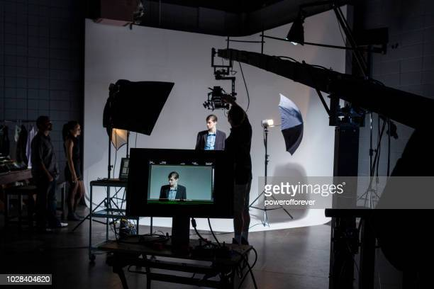people working behind the scenes on a film set - actor stock pictures, royalty-free photos & images