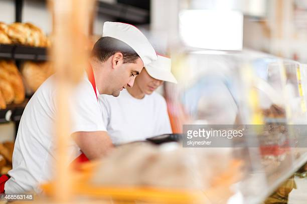 People working in a bakery.