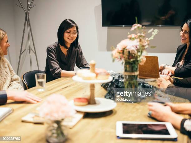 people working in a cafe coffee shop meeting space - wedding planner foto e immagini stock