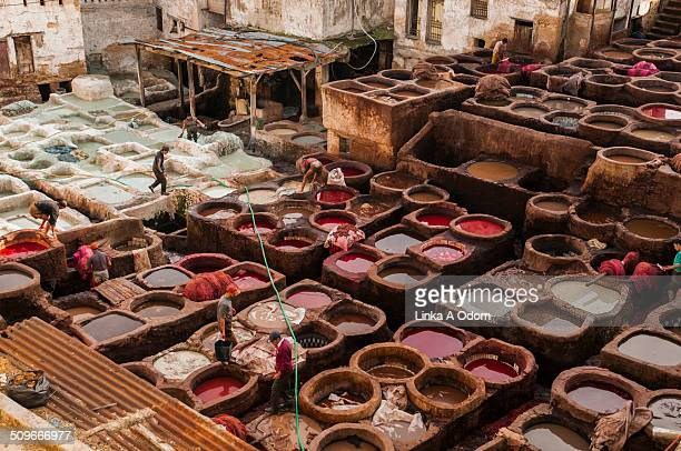People working in a leather tannery in Fez.