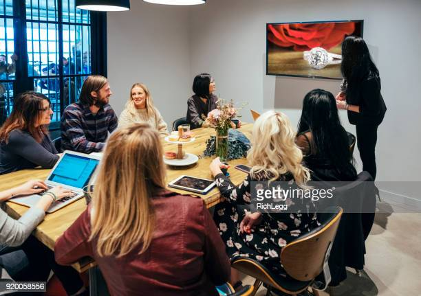 people working in a meeting space - wedding planner foto e immagini stock