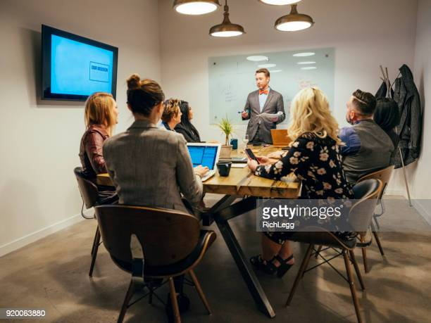 People Working in a Meeting Space