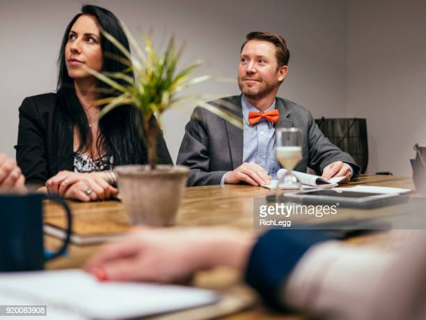 people working in a meeting space - rich_legg stock pictures, royalty-free photos & images